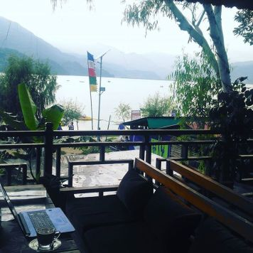 Getting work done by a Nepalese lake